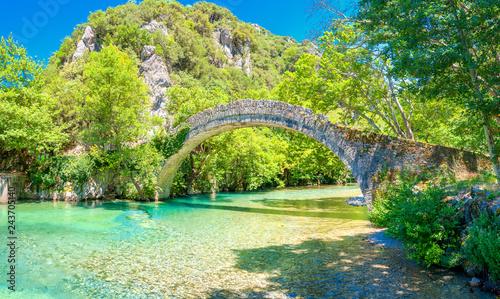 View of the old stone bridge Noutsos located in central Greece, Zagori, Europe