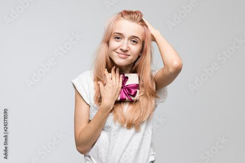 Studio portrait of cute blonde woman in white t-shirt