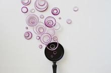 Conceptual Red Onion Ring Steam Over A Frying Pan