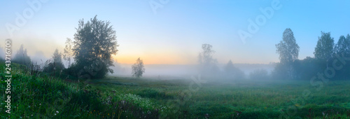 Montage in der Fensternische Blau Panorama of foggy lawn with growing trees on a background of sunrise sky.