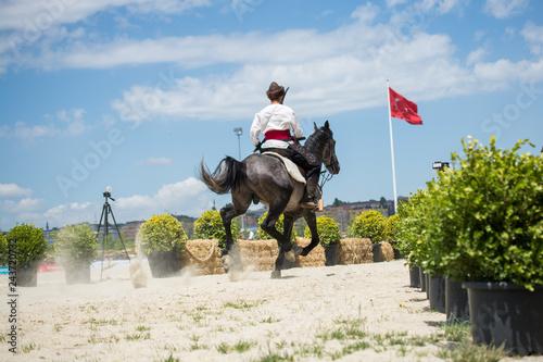 Photo  Turkish horseman  ethnic clothes examples