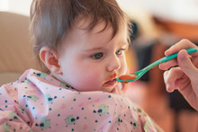 Weaning A Baby By Feeding Baby Food With A Spoon