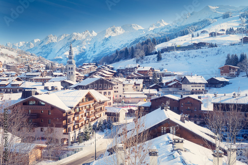 Foto auf Leinwand Aubergine lila La Clusaz, located in the French Alps in Haute Savoie, is a beautiful little village and a famous winter sports resort.