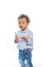 Boy With Curly Hair In Jeans A...