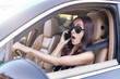 woman talking on the smartphone while driving a car