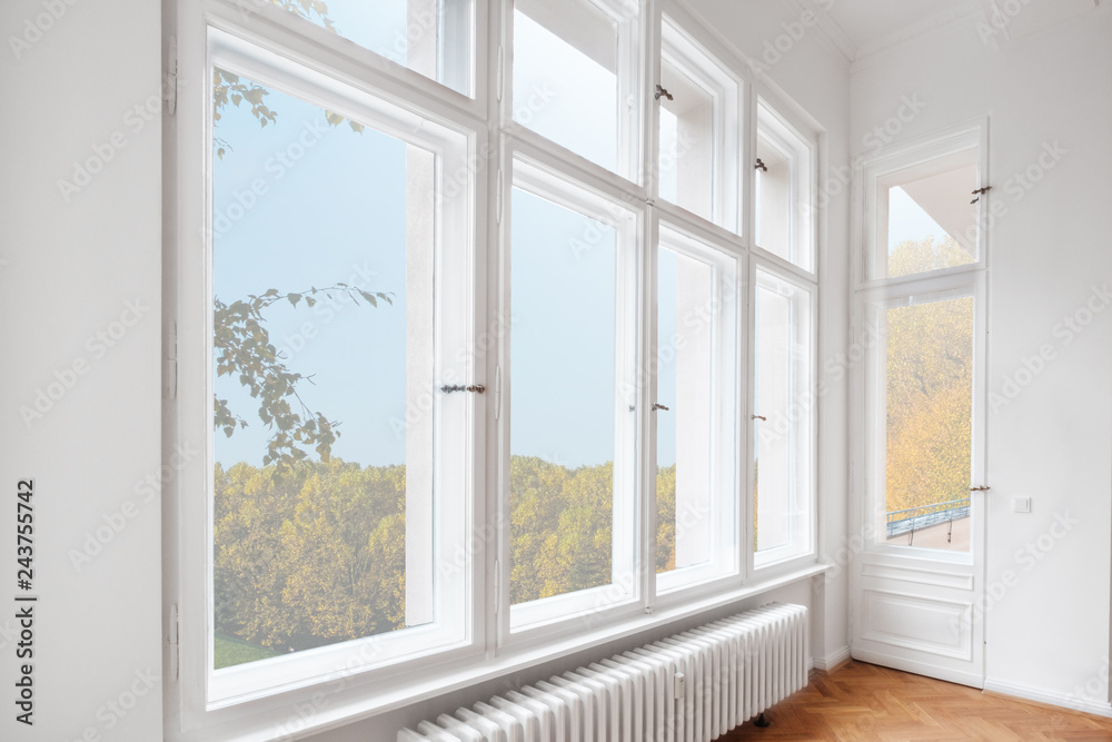 Fototapety, obrazy: big wooden windows in apartment room of old building