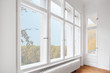 canvas print picture - big wooden windows in apartment room of old building