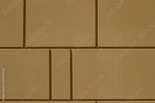 Modern brown color stone wall background with geometric shape blocks
