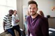 Leinwandbild Motiv Young designer smiling confidently in an office after a presenta