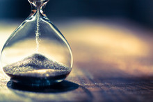 Hourglass As Time Passing Concept For Business Deadline, Urgency And Running Out Of Time. Sandglass, Egg Timer Showing The Last Second Or Last Minute Or Time Out.  With Copy Space.
