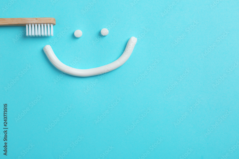 Fotografie, Obraz  Smiling face made of toothpaste, brush and space for text on color background, t