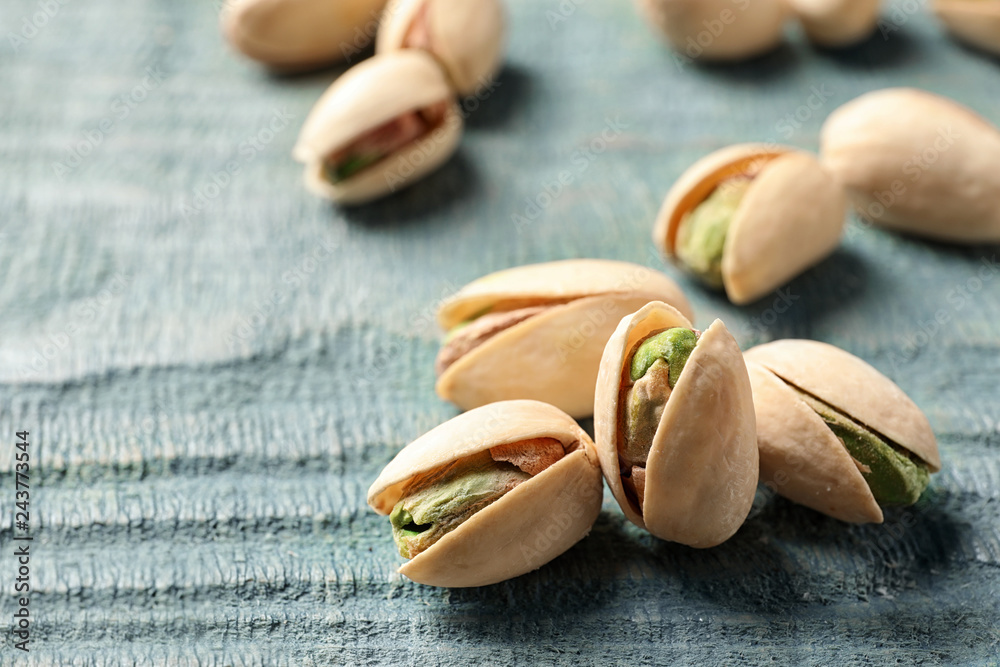 Fototapety, obrazy: Organic pistachio nuts on wooden table, closeup
