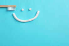 Smiling Face Made Of Toothpaste, Brush And Space For Text On Color Background, Top View