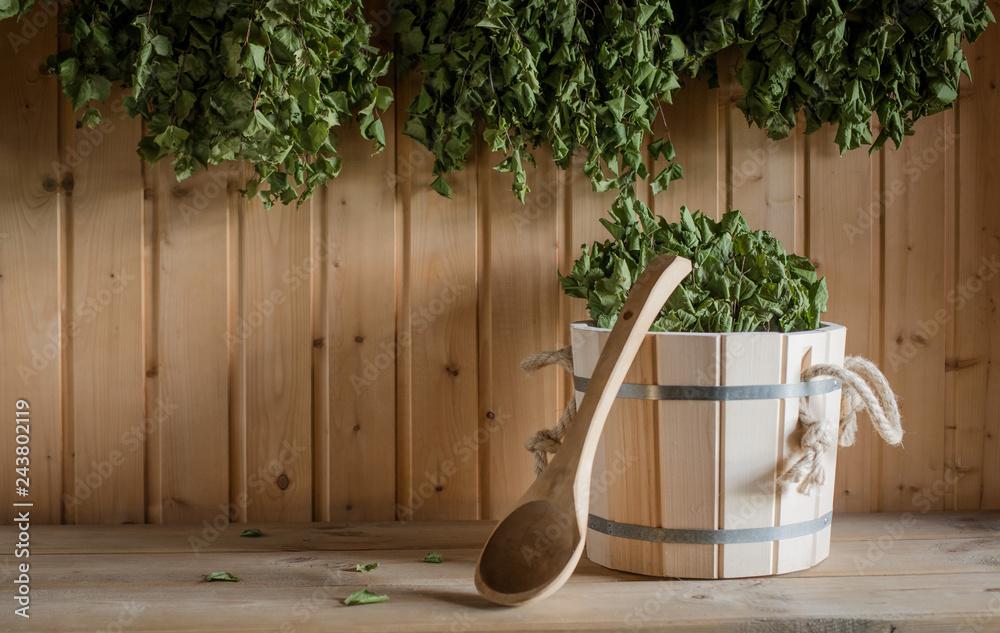 Fototapety, obrazy: A wooden bucket and a birch broom in a Russian bath. Sauna.