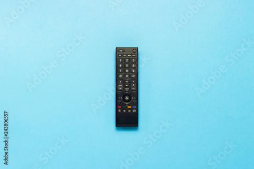 Cuadros en Lienzo Black remote control on a blue background