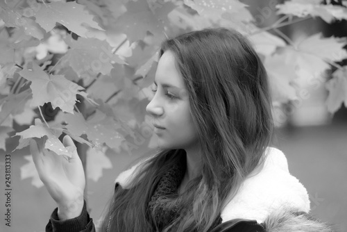 Fényképezés  long-haired brunette teenager with a blue jacket
