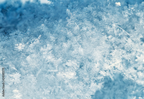 Foto auf AluDibond Himmelblau natural snow background from many crystals of snowflakes of various shapes and texture shimmer in the sun on a clear winter day