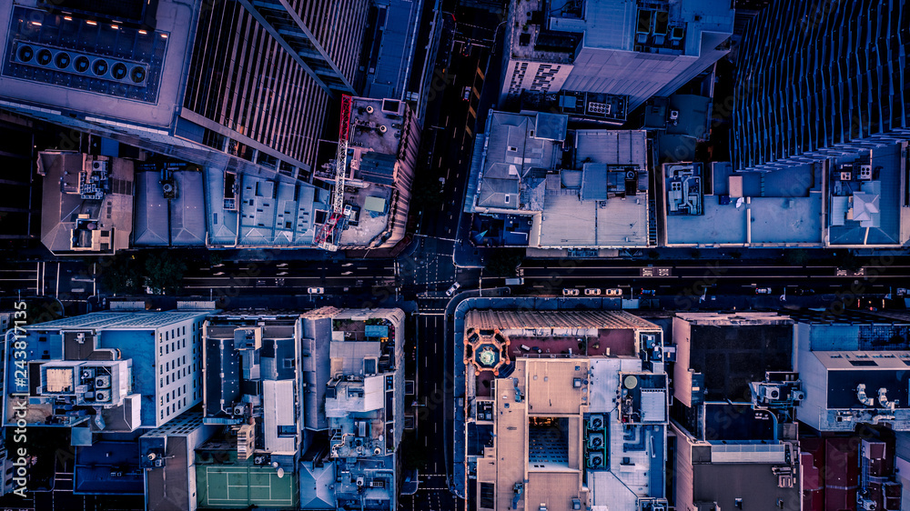 Fototapety, obrazy: City streets at dusk as seen from above. Aerial photograph