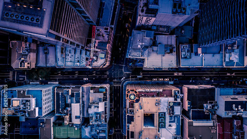 City streets at dusk as seen from above. Aerial photograph Wallpaper Mural