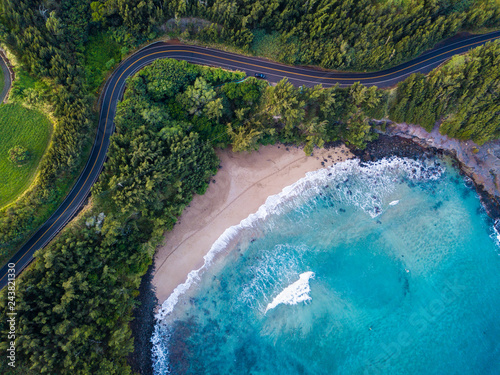 Fototapeta Aerial view of the sandy beach and curved asphalt road on the west coast of Maui