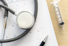 Medical Appointment Book In The Calendar  Stethoscope And Calendar Schedule To Check Up