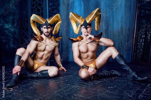 Fényképezés  men wearing a stage costume with big golden horns