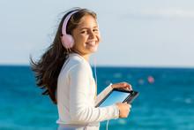 Cute Tween Girl With Headphone...