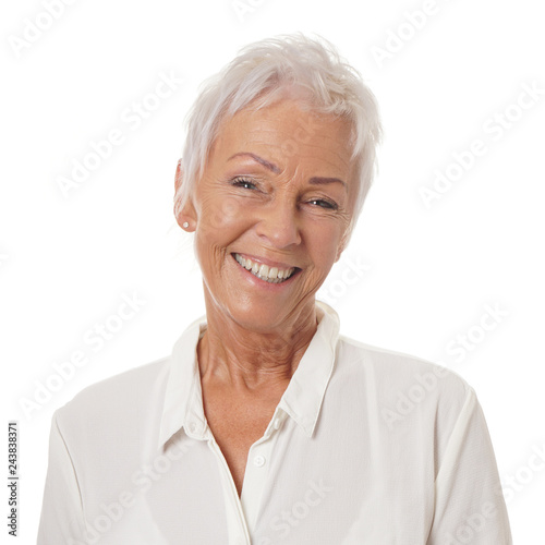Photographie  happy smiling older lady in her sixties with trendy white short haircut