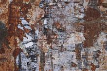 Rusty Metal Grunge Background With Peeling Poster Scraps