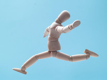 Man Jumping On Blue Sky Background