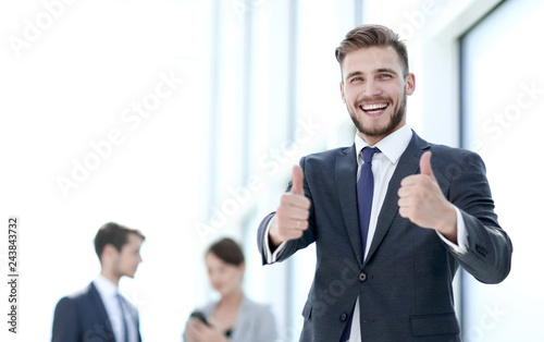 Valokuva  handsome businessman showing thumbs up