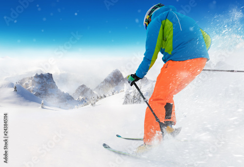 Young man skiing in Alps