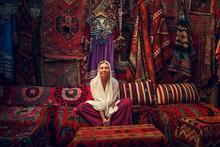 Woman Sitting In Carpet Shop, ...