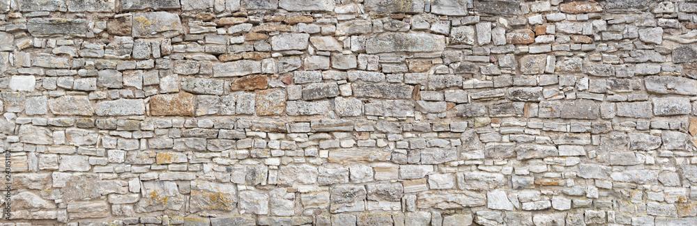 Fototapety, obrazy: Panorama - Alte graue Mauer aus groben, vielen kleinen, rechteckig gehauenen Natursteinen