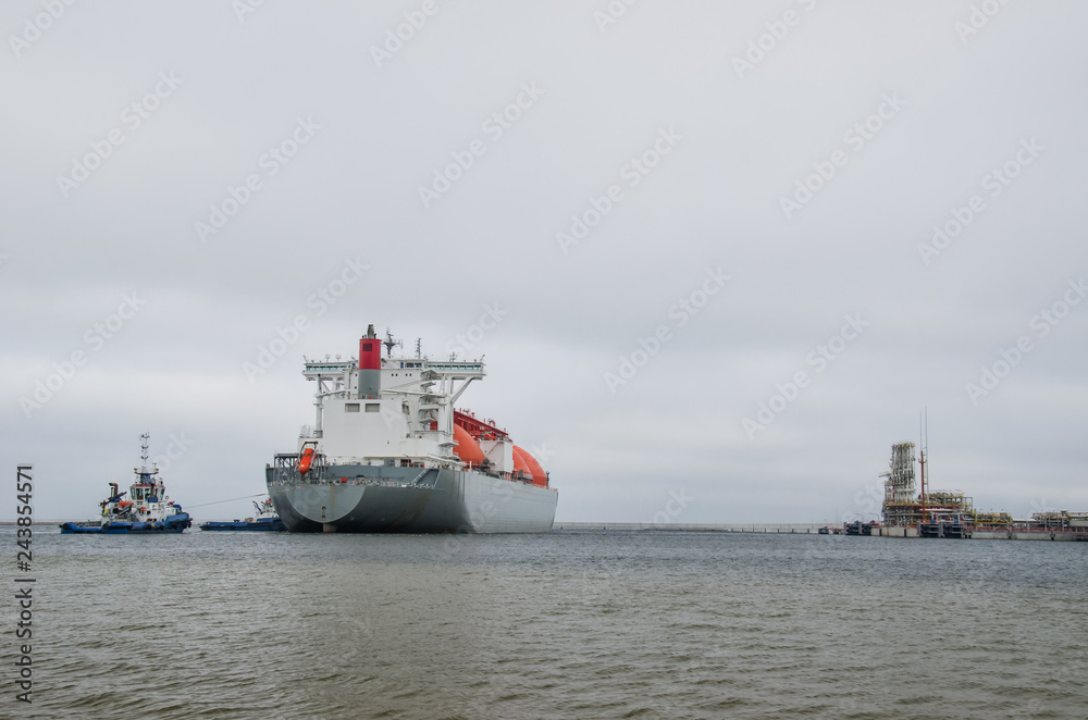 Fototapeta LNG TANKER - Ship and tugs are maneuvering at the gas terminal in Swinoujscie