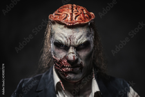 Scary zombie prostheric makeup on male model Fotobehang