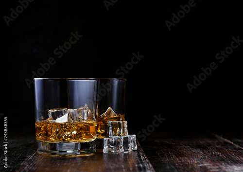 Poster de jardin Bar whiskey with ice in modern glasses