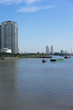 saigon river with blue sky and high building