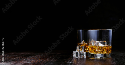 whiskey with ice in modern glasses Canvas Print