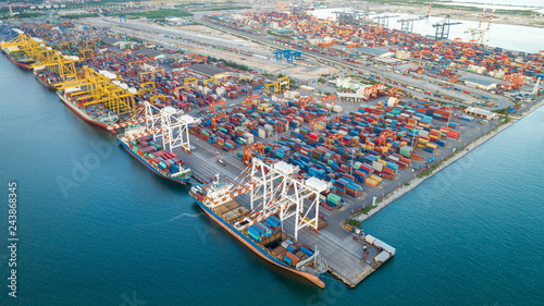 Foto auf Leinwand Shanghai Container ship in export and import business and logistics. Shipping cargo to harbor by crane. Water transport International. Aerial view