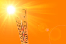 Illustration Of Orange And Yellow Color Depicting The Sun And An Ambient Thermometer