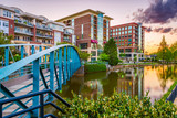 Greenville, South Carolina, USA downtown cityscape on the Reedy River at dusk