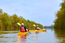 Two Yellow Kayaks At Danube River At Spring. Kayaking In Wilderness Areas.