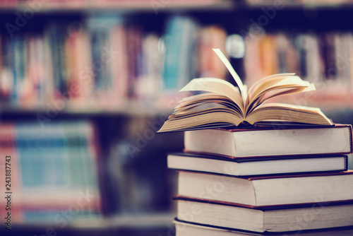 Fotografie, Obraz  Book in library with open textbook,education learning concept