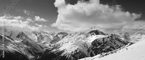 Foto op Plexiglas Grijs Black and white panorama of ski slope and cloudy mountains