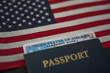 Passport card of USA covered by International American classic Passport on US Flag. Diagonal view.