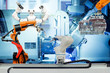 Industrial robotic welding, robot gripping and smart robot working on smart factory, on machine blue tone color background, industry 4.0 and technology, smart robotic working on teamwork concept.