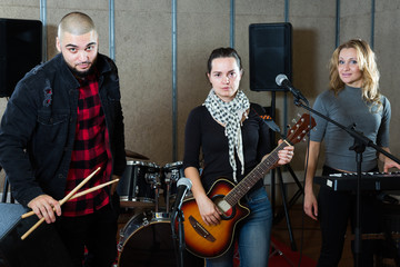 Young guitarist, drummer and keyboardist
