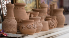 Row Of Clay Pots On The Shelf,...