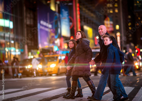 Photo  Family crossing Broadway in Times Square, New York City